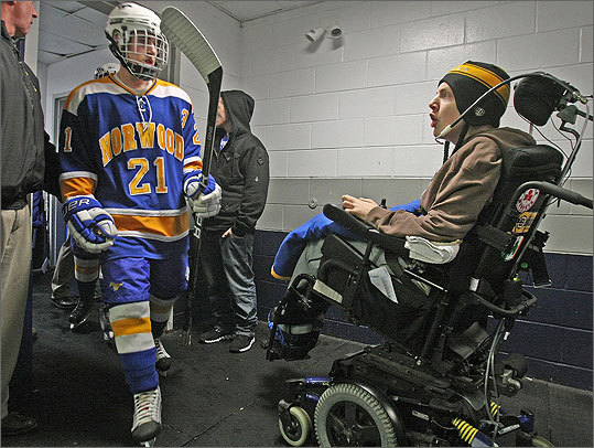 Matt Brown's life changed forever on Jan. 23, 2010, at Pilgrim Rink in Hingham, when he crashed into the boards in a game against Bay State Conference rival Weymouth leaving the Norwood High sophomore paralyzed. Norwood coach Bill Clifford made Brown an assistant coach this year. Between periods, Brown tells Clifford what he sees on the ice and more often than not, the coach agrees with him. At left, Brown shouts encouragement to Mark Maggio during a March 5 game against Marshfield. Read full story