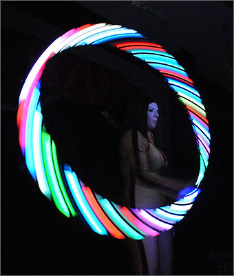 'Lydia's Carnival Sideshow' is held monthly at Life and Death at the Museum Place Mall in Salem. The next show is March 19. For more information, visit www.lydiascarnivalsideshow.com . Left: Nicole Sanders, also known as 'Nicole the queen of gyration,' performs with an LED hula hoop during