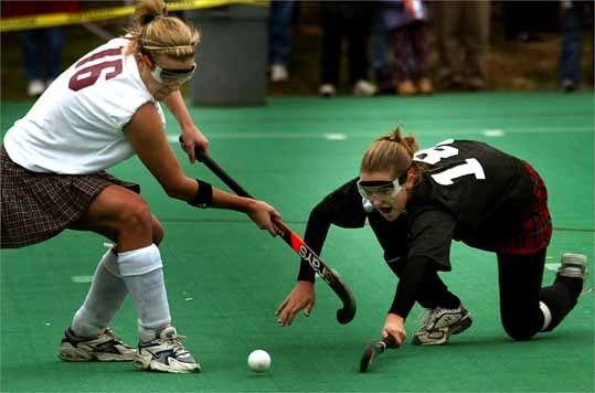 With three consecutive appearances on the Girl's All-Scholastics Ice Hockey Super Team, Rachel Wilkes (in white) represented Dedham 2002-2004. Rachel was recognized as Field Hockey Division 2 Player of the Year as a senior in 2004. She was also named to the 2003 All-Scholastics field hockey team as a junior.