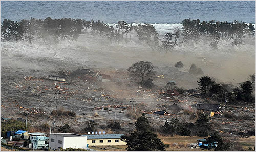 Waves hit residences in Natori, Miyagi prefecture, Japan.