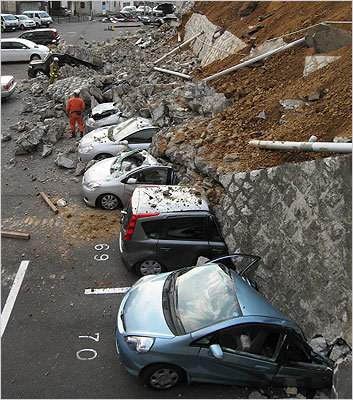 Vehicles were crushed by a collapsed wall in Mito, Ibaraki prefecture, Japan.