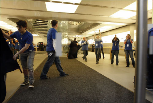 Apple employees prepared for the deluge of customers.