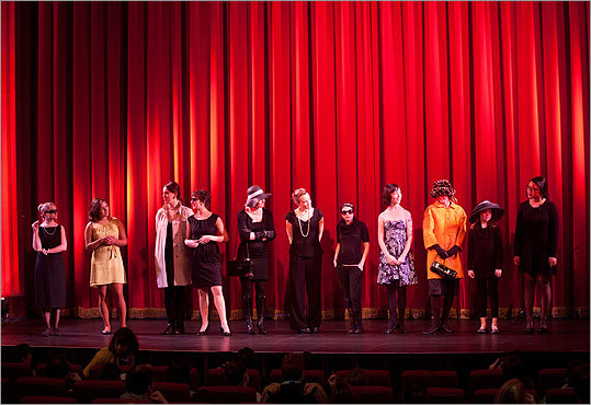 A group shot of the Audrey Hepburn look-alikes standing on stage.