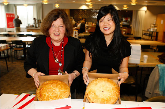 Luan Gilligan, left, and Jennifer Chan, both of Raytheon Company, show how sweet math can be on 'Pi' Day.
