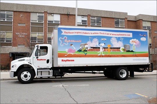 Raytheon Company's MathMovesU truck arrives at Waltham High School with a load of pies for 'Pi' Day.