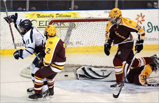 St. John's Prep's Colin Blackwell (11) scored against Weymouth goalie Brian Brady (35) on his way to a hat trick.