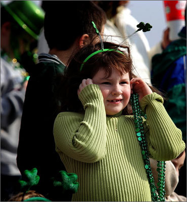 Shannon Kilduff, 6, of Malden holds her ears as the black powder guns fire during the parade. Date: March 19, 2005 Photographer: Matthew J. Lee, Globe Staff