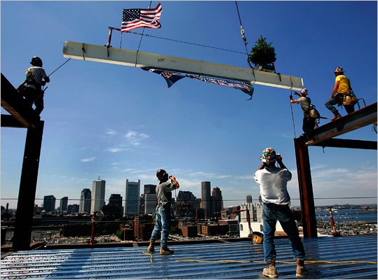 Pictured are construction workers walking across the beams at the Westin Hotel in 2005.