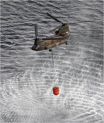 A helicopter scooped up water off Japan's northeast coast as it headed toward the Fukushima Daiichi nuclear power plant on Thursday.
