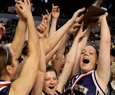 Arlington Catholic teammates celebrate their championship, with Rachel Buckley (right) lifting the state Division 2 trophy, after Sunday's game in Worcester.
