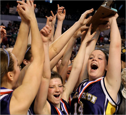 Division 2 girls Arlington Catholic's Rachel Buckley (right) celebrated with her teammates after they defeated Millbury for the first girls' basketball state title in school history. Arlington Catholic won the Division 2 final, 49-28. Story: Arlington Catholic wins first state girls' basketball title