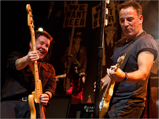 Bruce Springsteen joined the Dropkick Murphys for Friday night's encore at the House of Blues. It was the band's last performance of a three-night stand. Left: Springsteen played the encore with Ken Casey.