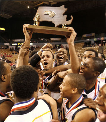 Division 2 boys New Mission's Samir McDaniels held up the trophy as his teammates celebrated after beating Northbridge Saturday in the Division 2 boys' basketball state final at the DCU Center in Worcester, which was host to six championship games. New Mission won 65-57. Story: New Mission claims D-2 title
