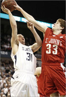 Division 1 boys St. John's Prep's Mike Carbon had a shot attempt blocked by St. John's of Shrewsbury's T.J. Kelley.