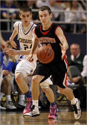 Division 3 boys Watertown's Danny Kelly (right) had a step on Whitinsville's Colin Richey as they chased a loose ball in the Division 3 final. Story: Watertown falls in D-3 final