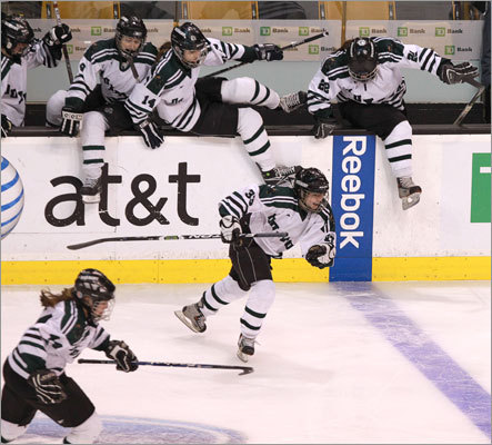 Duxbury's second and third lines jump off the bench to go celebrate the win.