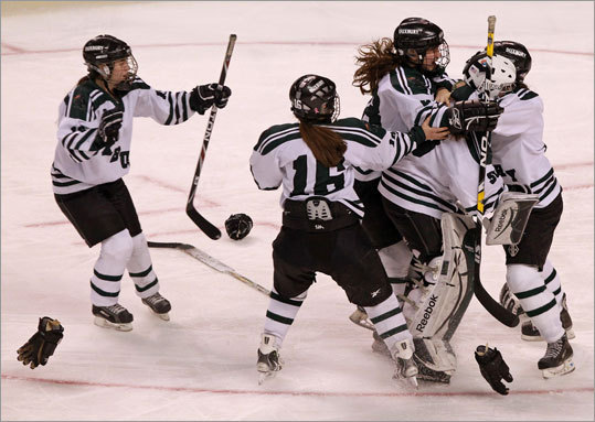 Duxbury girls celebrated after winning the Division 2 state hockey championship.