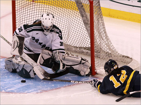Fontbonne's Elizabeth Coleman (12) was unable to get this shot past Duxbury's goalie Rachel Myette (30) during the second period.