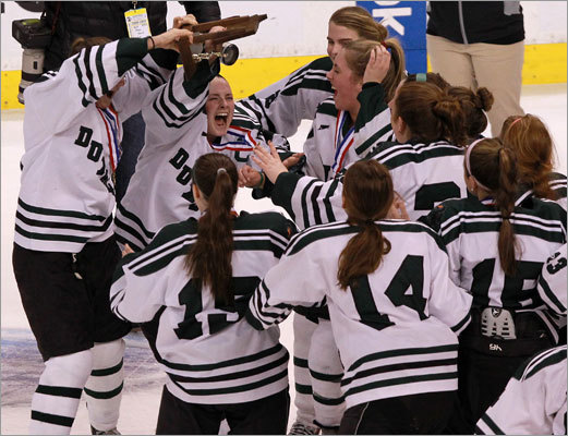 Duxbury hoists the state championship trophy.