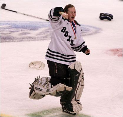 Duxbury goaltender Rachel Myette tossed her gloves and mask to join the celebration.