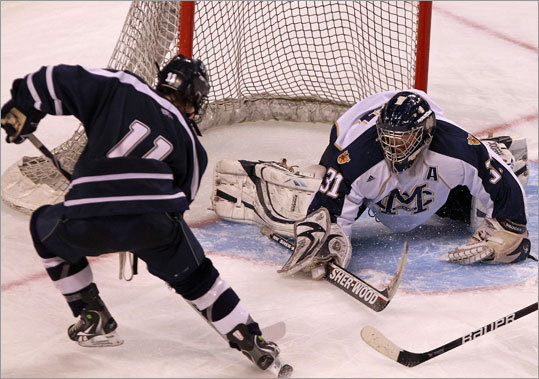 Malden Catholic goalie Patrick Young (31) turned aside a shot by St. John's Colin Blackwell.