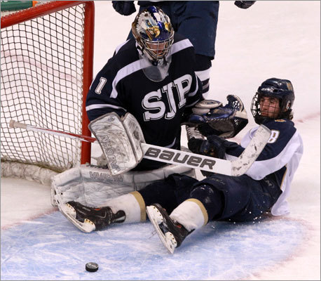 Malden Catholic's Mike Vecchione (8), tied the score at 3-3 with this goal in the second period.