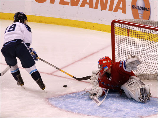 Tewksbury goalie Niko Cunha (30) turned aside a breakaway attempt by Franklin's Nick Bertoni.