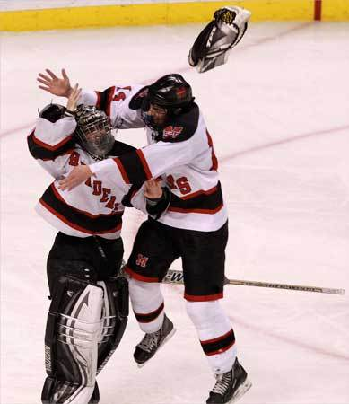 Marblehead goalie Tony Cuzner and teammate Jake Kulevich celebrate their state championship at TD Garden.