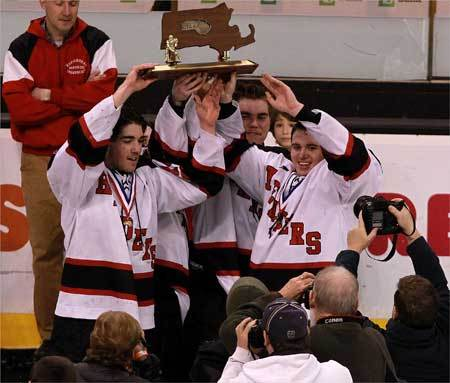 Marblehead team captains show off the state championship trophy after their victory.