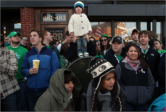 Ryan Higgins of South Boston watched the parade from on top of a mailbox with the help from his father.
