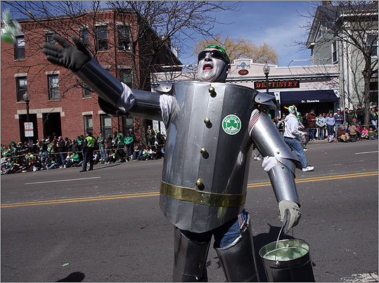 Bobby O'Brien dressed as the Tin Man, tossed candy into the crowd. He was representing the Sheet Metal Workers Local 17.