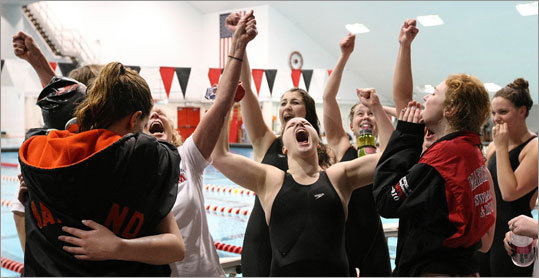 Girls swimming Marblehead, right, rejoiced after winning the last and deciding relay in the Division 2 swimming and diving championships as Wayland swimmers consoled themselves. Lincoln-Sudbury won the Division 1 girls state title. Story: Marblehead comes through Lincoln-Sudbury outlasts Westford
