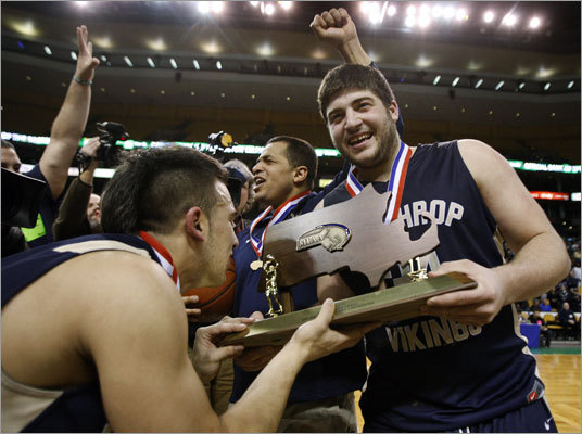 Division 4 boys basketball Winthrop captain Anthony Hatzisavas held the Divisin 4 state trophy as teammate Taj Gennerazo leaned in to kiss it while head coach David Brown celebrates their 58-55 victory over Cohasset at TD Garden. Story: Winthrop celebrates its 'unbelievable' championship