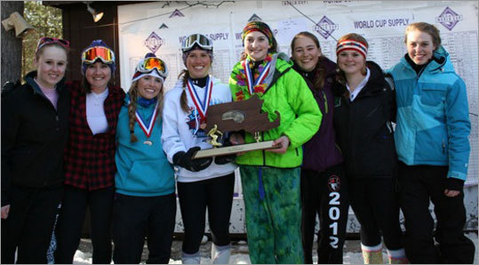 Skiing Marblehead's girls ski team accepted the first place state trophy after finishing atop the alpine standings. Andover finished atop the boys standings. Story: Marblehead skiers are down for more