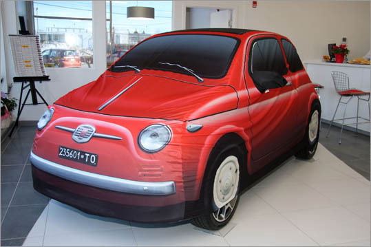 "When customers take delivery, the Prima Ediziones are under a cover that looks like one of the original Fiat Cinquecentos. Once uncovered, it's immediately apparent the new 500 is taller and more rounded than its ancestor. ""There's talk of making the covers available as an accessory,"" said Kelly sales manager Patrick Afthim."