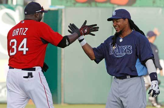 The Red Sox faced the Rays on exhibition action on Tuesday. Before the game, former teammates Manny Ramirez and David Ortiz embraced.