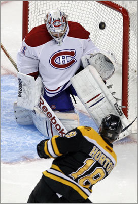 Bruins right wing Nathan Horton lifted the puck over the shoulder of Canadiens goalie Carey Price in the third period. Horton's second goal of the game made it 4-0.