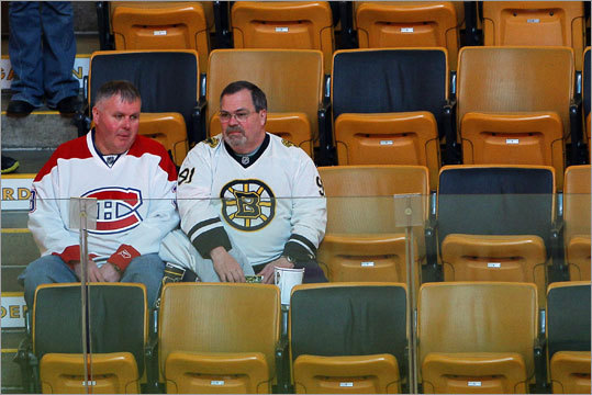 A pair of fans with split allegiances waited for the start of the game at TD Garden.