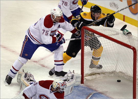 The Canadiens' Hall Gill and goalie Carey Price, along with the Bruins' Brad Marchand had a front-row view of Campbell's first-period goal.