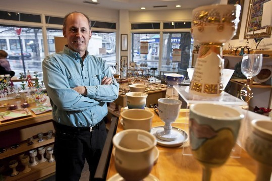 "And Lev Friedman, owner of Kolbo Fine Judaica, plans to retire after nearly 30 years. But Friedman says he intends to find a buyer first, and has no plans to close the store. One loyal customer calls it a ""Jewish-quality Tiffany's,"". Owner Lev Friedman at Kolbo Fine Judaica."