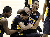 VCU guard Brandon Rozzell (left) celebrates Darius Theus