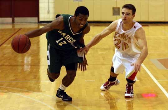 Milton High senior Marcus McDermott was named to the Super Team on the 2009 All-Scholastic boys' basketball team. McDermott, left, currently plays college basketball at Babson University.