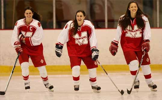 Shana Indelicato, middle, was named to the 2008 All-Scholastic girls' ice hockey team for her work on the ice as Milton High forward.
