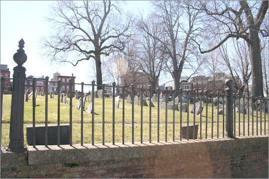 Correct answer: Atop the gates at Copp's Hill Burial Ground.