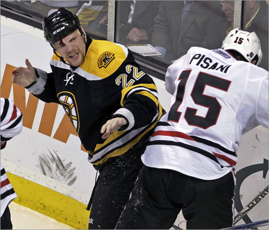 Shawn Thornton came up bloodied during a second period play with Chicago's Fernando Pisani.