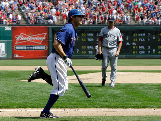 April 3: Rangers 5, Red Sox 1 Rangers second baseman Ian Kinsler (left) ran toward first base after his solo home run off Clay Buchholz in the third inning.