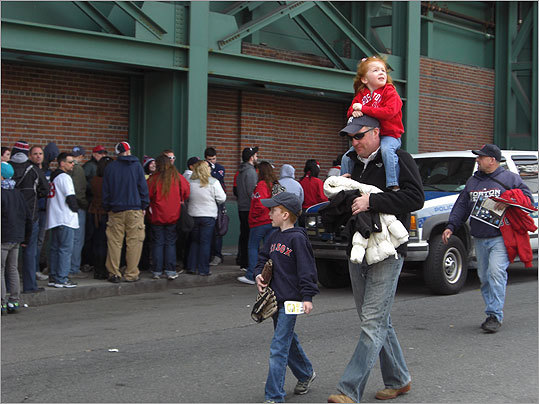 The Red Sox finally returned home and beat the Yankees 9-6 during their first game at Fenway Park. Take a look at photos of Sox fans around the Fenway area. Check out photos of Fenway's home opener through the years . Some young fans brought their baseball mitts to the ballpark.
