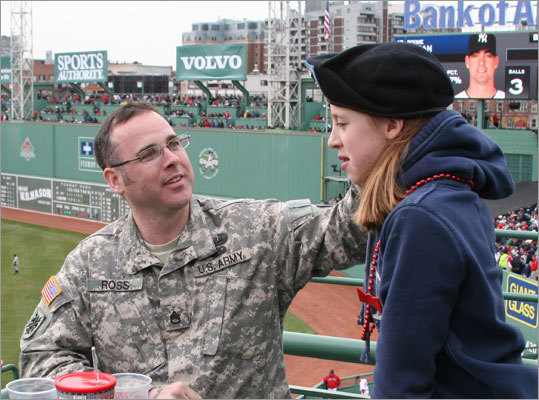 Army staff sargent Stephen Ross, from Nashua, N.H., was honored at Fenway Park during the game. Sgt. Ross survived an attack when his Humvee was hit by a road side bomb in Iraq in 2003. He received a Bronze Star and Purple Heart for his efforts. With him is his daughter Zoe Ross.