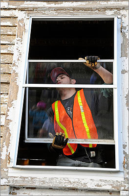 Workers removed the windows from the house ahead of the move.