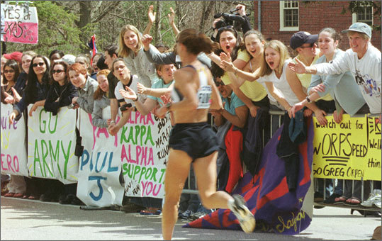2001 Wellesley students cheer on one of the thousands of runners.
